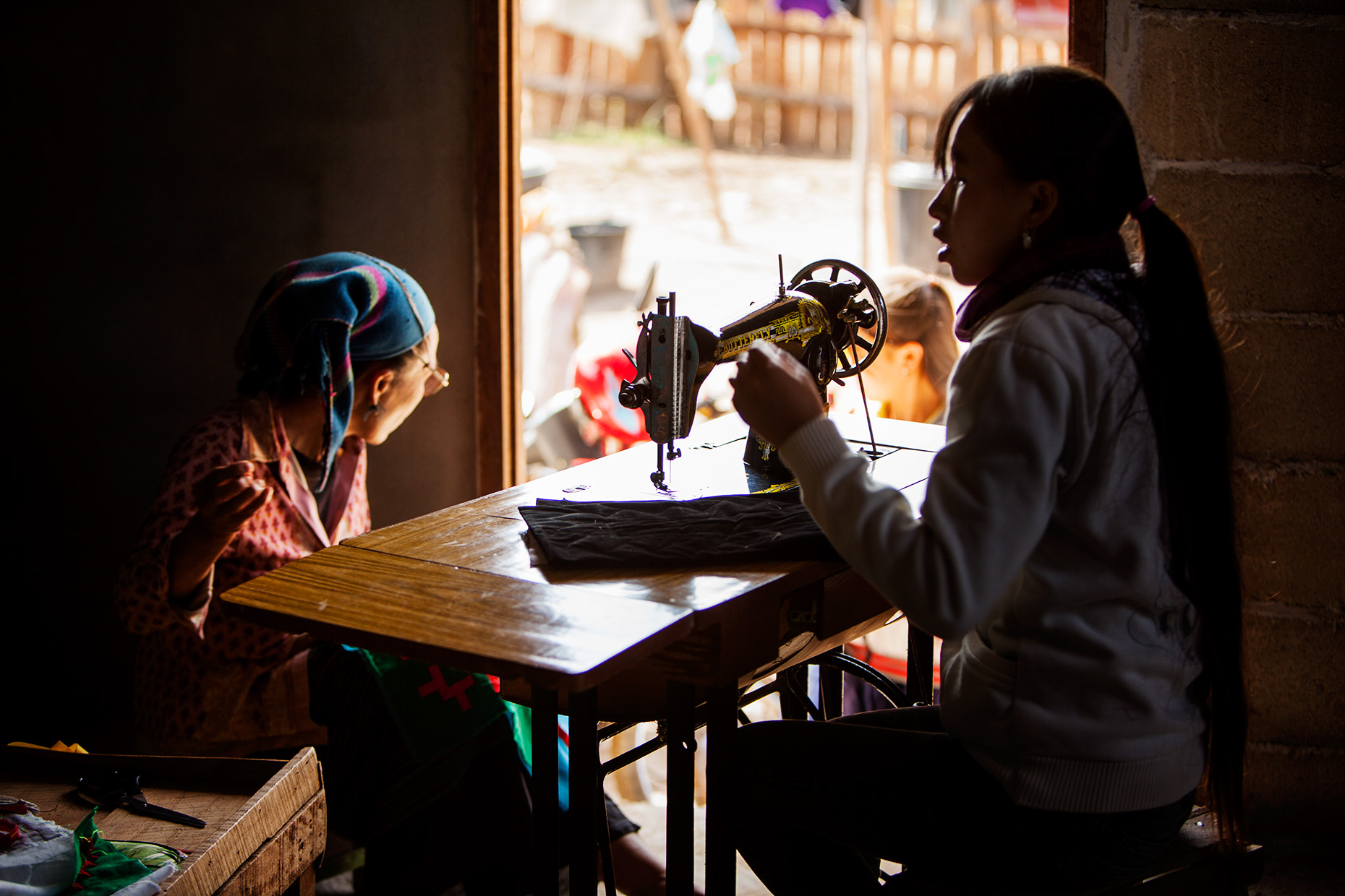 Hmong people sewing