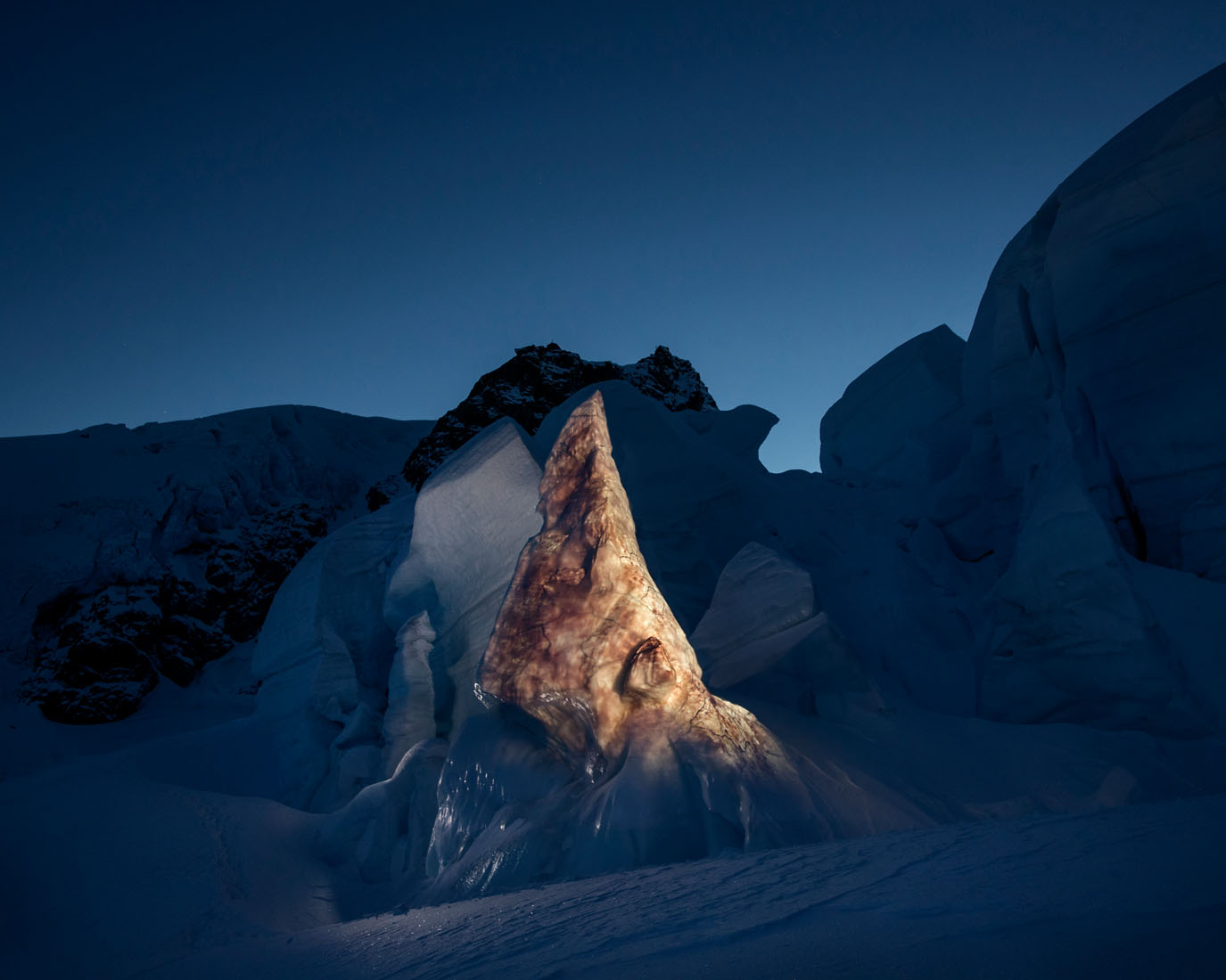 Nameliss light projection on glacier